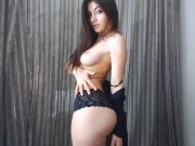 brunnete dancing in topless in