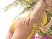 Busty asian in yellow bikini posing her huge