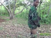 Army boy strokes his wood in the woods