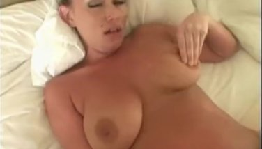 Busty babe toying her pussy
