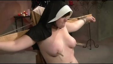 Latex blonde punishes chubby nun with paddles