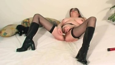 MILF fucks her ass with dildo and squirts