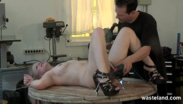 Blonde slave is tied down and flogged