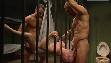 HUNKY PRISONERS SPIT ROAST BEHIND BARS