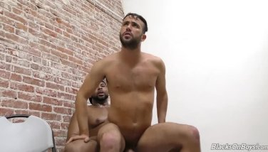 Bearded guy sucks a black cock at a gloryhole