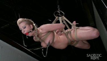 Hot blonde pain slut suffers through grueling suspension bondage.