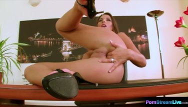 Brunette Zafira gets bored at work and fucks herself with a pink dildo