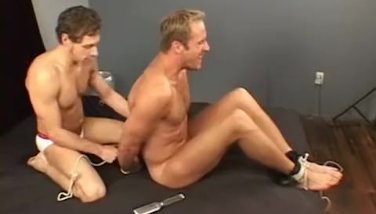 A masculine guy tied up and tickled
