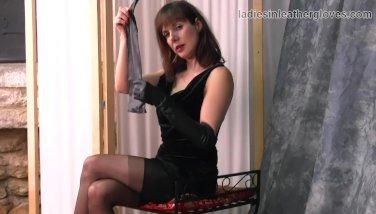 Posh brunette milf in nylons enjoys the feeling of her soft leather gloves
