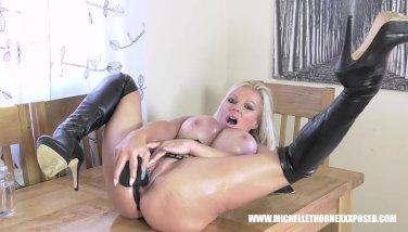 Blonde biker babe Michelle Thorne covered in oil wanks big black dildo toy