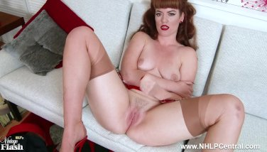 Redhead Zoe Page teases her pert tits and wet pussy in retro red lingerie