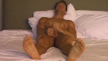 Horny Michael shows off his hot feet while stroking his cock