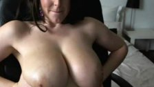 Sexy woman teasing her butt and boobs on cam