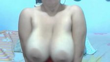 Big titted MILF fingers her pussy on webcam