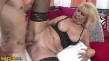 Busty blonde mature riding a cock