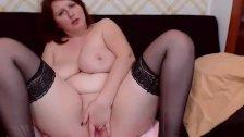 Busty redhead MILF masturbates on webcam