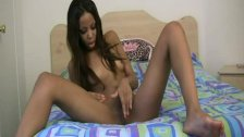 ebony teen masturbates legs wide open
