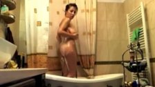 Huge Titty Webcam Girl Takes A Shower