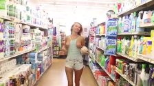 Blonde girl flashing boobs in the supermarket