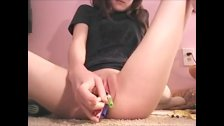 18yo  sticks objects in her pink pussy hole