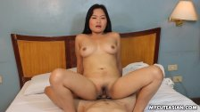 Medium sized Asian bitch rides a cock cow gir