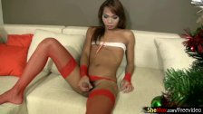 Gorgeous ladyboy in red thongs and stockings