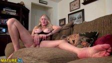 Big titted American mature lady masturbating