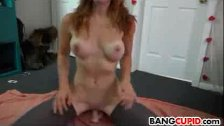 Stunning redhead plays with her toy