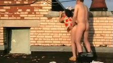 1fuckdatecom Amateur couple fucking on roof