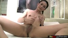 Thai ladyboy with small tits gets her cock covered in jizz