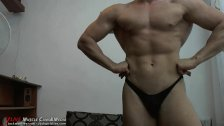 Hot muscleman flexes his hard body. at JockMenLive