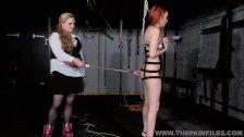Suspended lesbian whipping and strict lezdom bondage of spanked slave girl