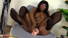 Black girl in nylons masturbates and shows footjob skills