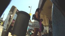 Upskirt spy cam takes a shot at chubby brunette's ass