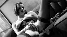 Bobbi masturbates in a corset and stockings