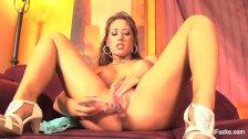 Capri Cavanni puts a glass dildo in her pussy