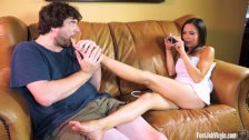 Hot brunette gets her feet worshipped