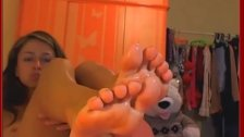 webcam girl is licking her toes
