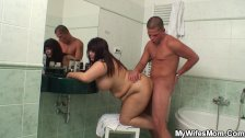 Busty mom and boyfriend in the bathroom