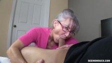 Granny sucks a young dick