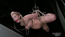 Hot blonde pain slut suffers through grueling suspension bondage.