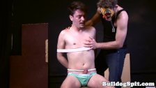 Restrained underwear lad gets oily handjob