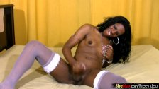 Pretty ebony tranny poses in white stockings and masturbates