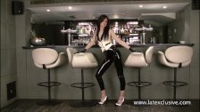 Shiny latex barmaids rubber fetishwear and high heel babe posing in solo