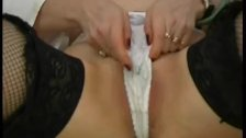 Slut working her holes with speculum in gyn chair