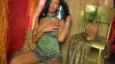 Ebony babe rubs her pussy