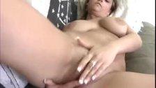 Busty Carmella massaging her pussy