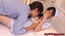 Aino Kishi Japanese nurse shows off her tits