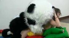Sporty sexy teen fucks with panda