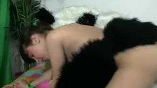 Brunette girl seducing a panda